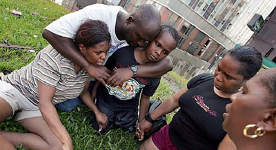 A family of Hurricane Katrina survivors prays
