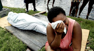 A woman grieves the loss of a family member