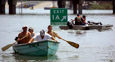 Hurricane Katrina survivors transport themselves with boats