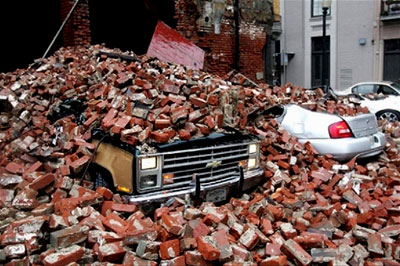 Cars crushed by bricks