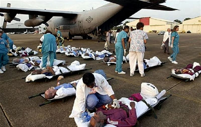 Injured and sick Hurricane Katrina survivors wait to be transported to a hospital