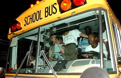 Hurricane Katrina survivors evacuate on a school bus