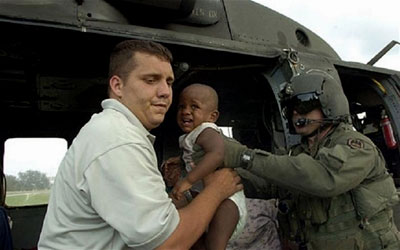 National Guard members transport a young boy