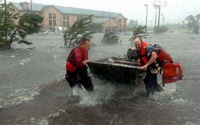 Two men fight the strong wind of Hurricane Katrina