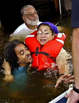 A distraught woman is brought to safety