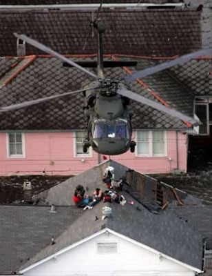 A National Guard Member prepares Hurricane Katrina residents for an air rescue