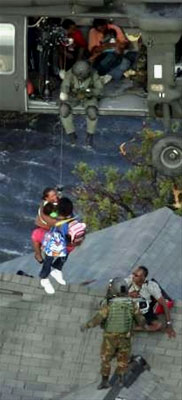 Two Hurricane Katrina survivors are rescued by National Guard members